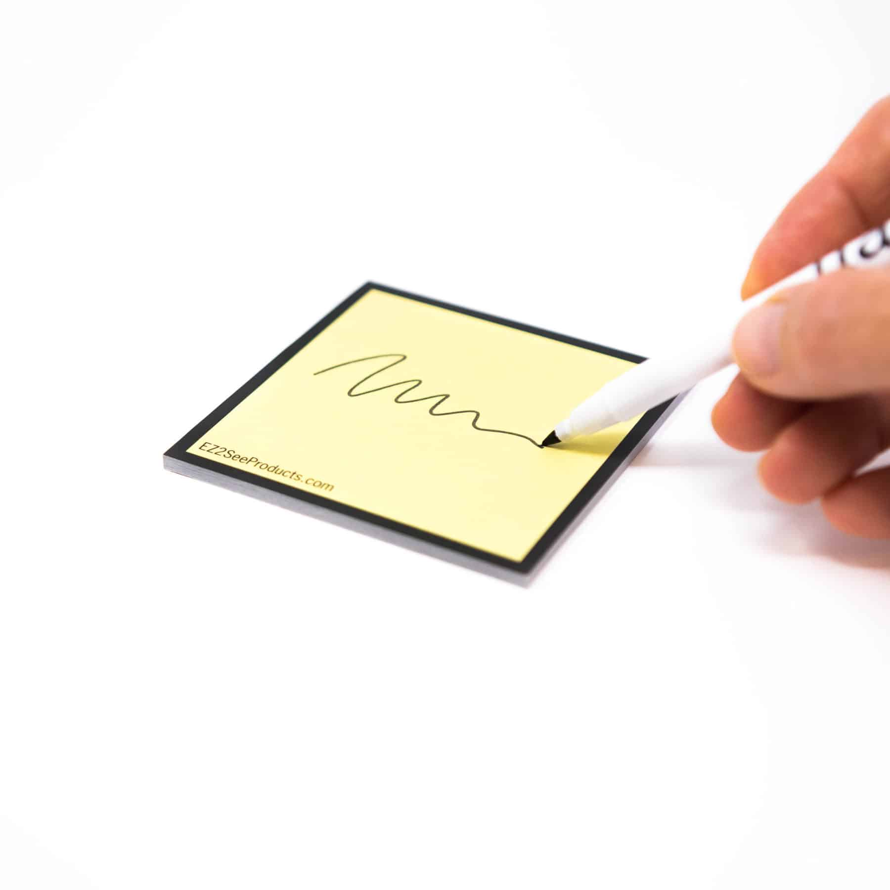 high contrast sticky note with pen
